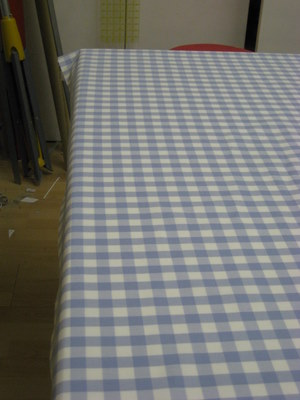 Off grain check fabric before being worked on
